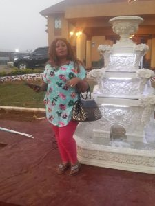 A guest stands by a miniature statue erected at Jandy