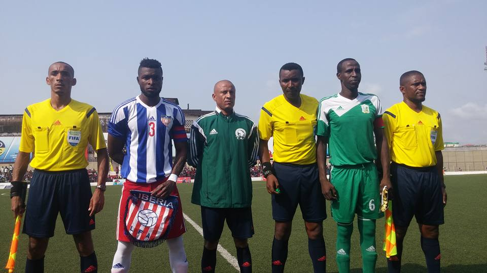 Captain Teah Dennis with match officals