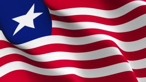 """The flag of any nation is a symbol of pride and unity. A nation's flag can also be a symbol of disunity. Liberia is such a country whose flag it has been argued in many quarters is misrepresent instead of uniting its people. The Liberian flag is a symbol of what I referred to as """"misrepresentation"""". By misrepresentation, I mean its so-called national colors – red, white and blue (horizontal stripes of red and white and a blue field with one star) are a copy of the American flag plagiarized by Susannah Lewis who thought she was Betsy Ross, who is credited with making the first American flag. This irritation represents only a segment of the Liberian society and excludes the rest. And as such, the symbol doesn't arouse the united front of the Liberian citizenry like the American flag."""