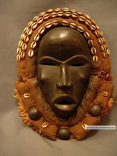 """The Grebo of the Ivory Coast and Liberia carve masks with round eyes to represent alertness and anger, with the straight nose to represent unwillingness to retreat. The Senoufo people of the Ivory Coast represent tranquility by making masks with eyes half-shut and lines drawn near the mouth. The Temne of Sierra Leone use masks with small eyes and mouths to represent humility and humbleness. They represent wisdom by making bulging forehead. Other masks that have exaggerated long faces and broad foreheads symbolize the soberness of one's duty that comes with power."".4."
