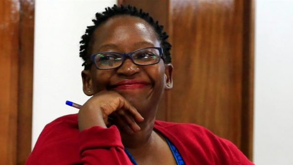 Activists condemned the jailing of Stella Nyanzi for cyber harassment, saying it undermined Uganda's commitment to freedom of expression. She attended Friday's sentencing via video link, against her will, and exposed her breasts in protest.